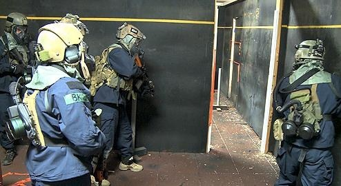 "Live-fire close-quarter battle exercises in the Hostage Rescue Team's ""shooting house"" mimic real-world missions."
