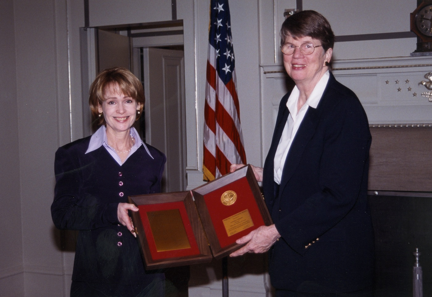Kathryn Turman receives a commendation from Attorney General Janet Reno in 2000.