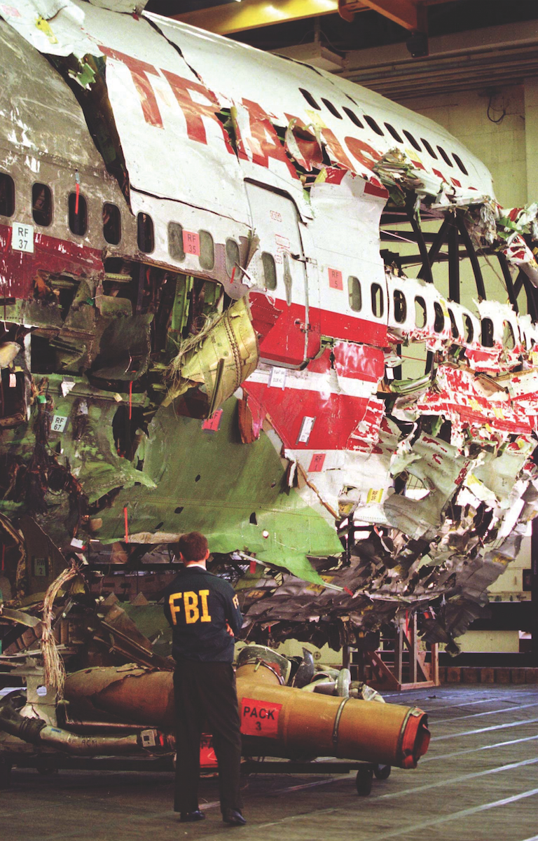 The mysterious mid-air explosion of TWA Flight 800 some nine miles off Long Island in July 1996 led to a long and difficult investigation. The FBI's scuba team in New York helped scour a 40-square-mile patch of the ocean floor, recovering the remains of all 230 victims and over 95 percent of the airplane. Terrorism was initially suspected as the source of the explosion, and despite a raft of speculation, a massive, 17-month investigation by the FBI's Joint Terrorism Task Force and the National Transportation Safety Board concluded that the explosion was caused by mechanical failure. Here, an FBI agent stands next to the reconstructed plane in a Navy hangar. Reuters.