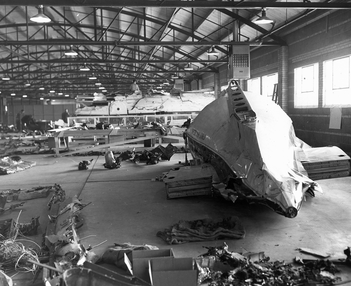 Wreckage of United Airlines flight 629 that crashed November 1, 1955 in Colorado, laid out in a Denver warehouse to solve the mystery of the bombing by Jack Graham.