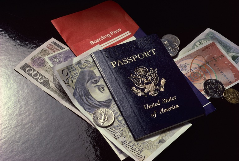 U.S. Passport on Foreign Currency (Stock Image)