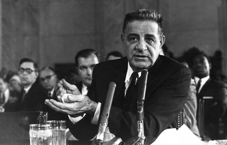 Joseph Valachi testifies before the Senate on October 1, 1963, showing how he was initiated into the Mafia by having to burn a crumbled ball of paper in his hands while taking the mob oath. AP Photo.