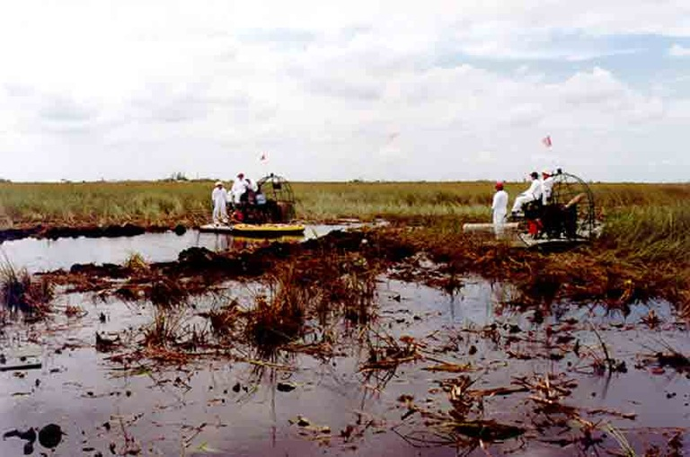 Recovery personnel at the crash site of ValuJet Flight 592, which went down on May 11, 1996 in the Everglades. FAA photo