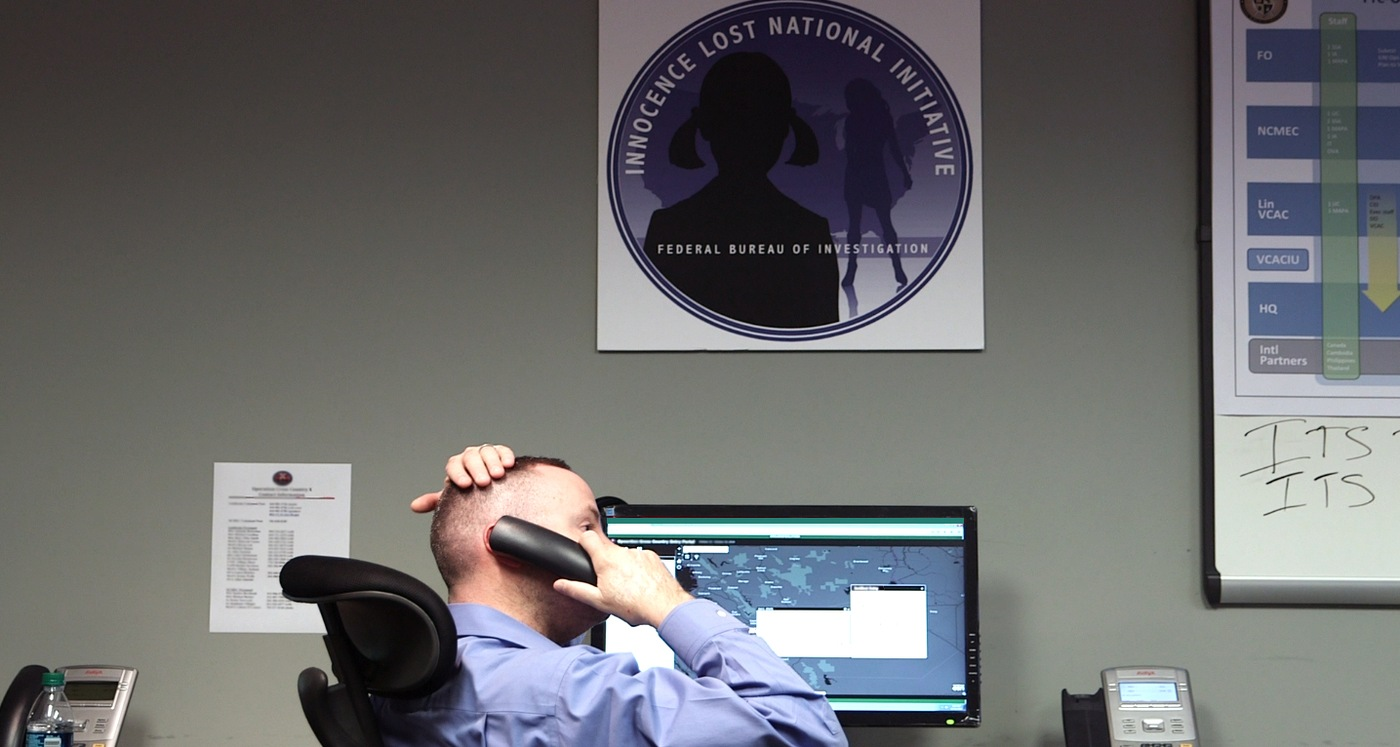 An investigator with the FBI's Violent Crimes Against Children Unit at a workstation at a command center in Maryland.