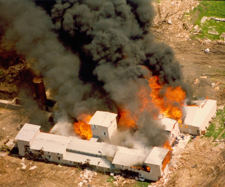 Aerial view of Branch Davidian compound near Waco, Texas, in flames on April 19, 1993 following a 51-day siege by the FBI and law enforcement.