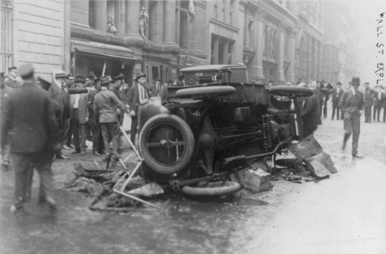 Aftermath of bombing at Wall Street financial district in New York on September 16, 1920, killing over 30 people and injuring some 300. Library of Congress photo.