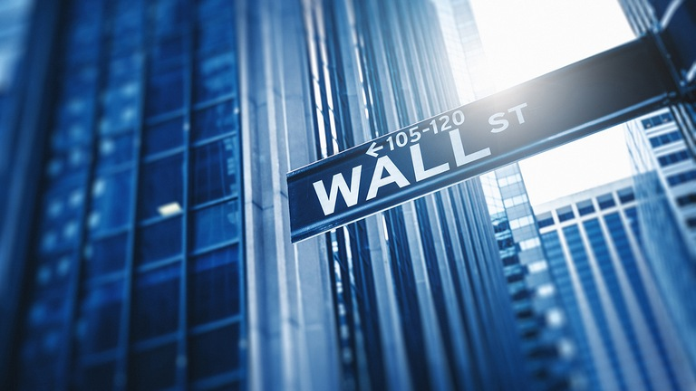Stock image of a street sign for Wall Street in New York City.