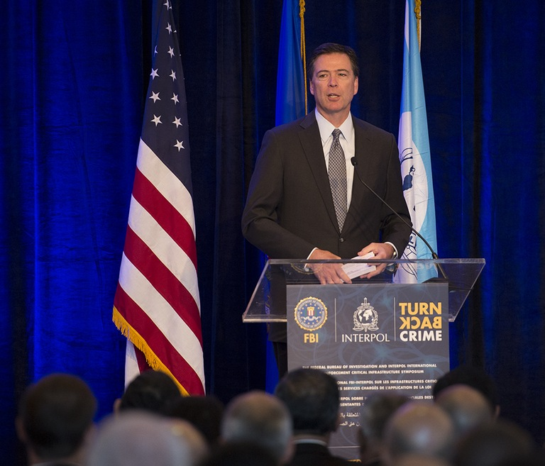 FBI Director James Comey speaks at the International Law Enforcement Critical Infrastructure Symposium in Miami on July 7, 2014. Photo courtesy of Interpol.