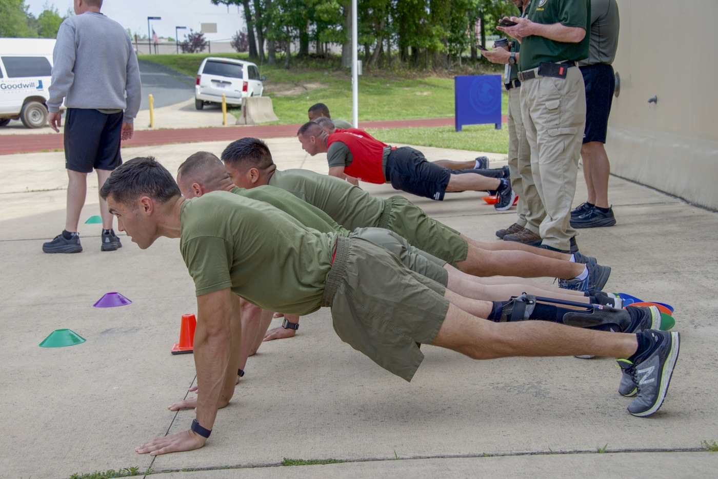 FBI, FBI National Academy, and Marine Corps participants perform planks during a May 22, 2019 training and networking event with the Marine Corps Wounded Warrior Regiment at the FBI Academy in Quantico, Virginia.