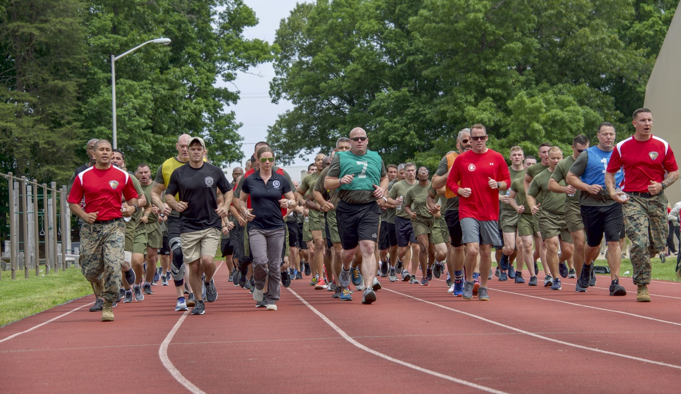 FBI, FBI National Academy, and Marine Corps participants run on the track during a May 22, 2019 training and networking event with the Marine Corps Wounded Warrior Regiment at the FBI Academy in Quantico, Virginia.