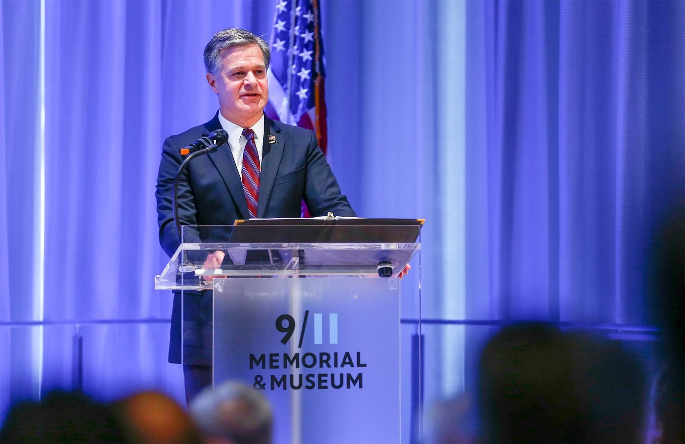 FBI Director Christopher Wray speaks about compensation available to federal first responders with 9/11-related illnesses at the 9/11 Memorial & Museum in New York City on September 7, 2018. (Photo credit: Jin S. Lee, 9/11 Memorial)