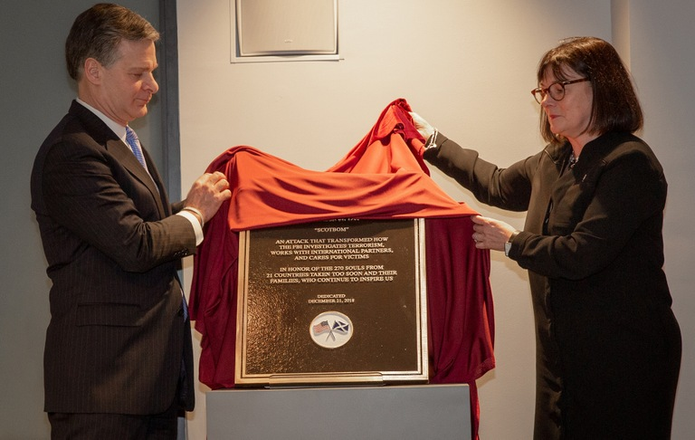 FBI Director Christopher Wray and Scottish Solicitor General Alison Di Rollo unveil a plaque honoring the victims of Pan Am Flight 103 during a ceremony at FBI Headquarters on December 20, 2018 marking the 30th anniversary of the December 21, 1988 terrorist attack.