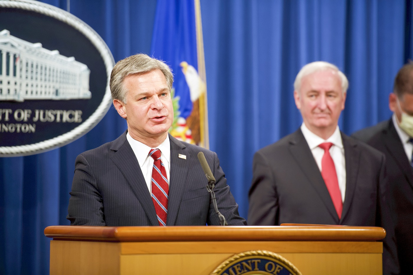 FBI Director Christopher Wray speaks at a September 22, 2020 press conference at the Department of Justice announcing the results of Operation DisrupTor as Deputy Attorney General Jeffrey A. Rosen looks on.