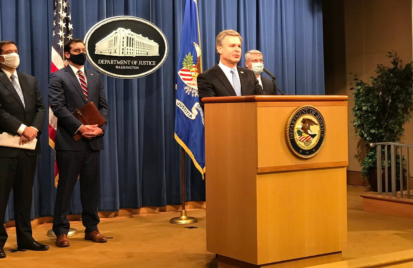 FBI Director Christopher Wray speaks at an October 7, 2020 press conference at the Department of Justice where charges were announced against two ISIS militants.