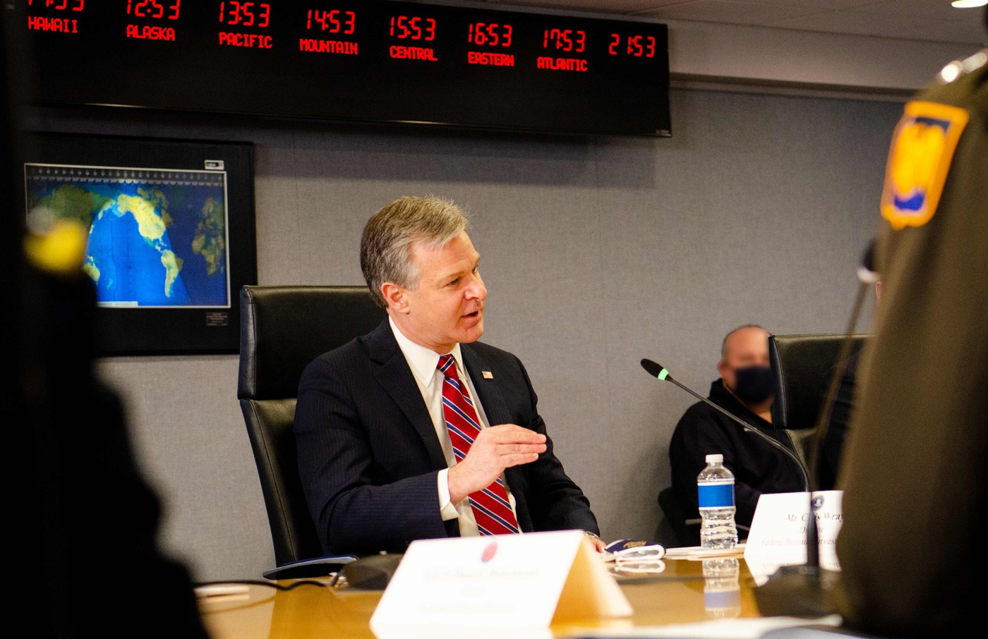 FBI Director Christopher Wray speaks during an inauguration security briefing to Vice President Mike Pence with other agency officials at FEMA Headquarters in Washington, D.C. on January 14, 2021.