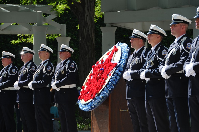 Law enforcement officers participate in a wreath-laying ceremony honoring colleagues who died in the line of duty during an event at the National Law Enforcement Officers Memorial on May 15, 2016 in Washington, D.C.