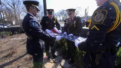 Flag-Raising Honors Fallen Agent Edwin R. Woodriffe