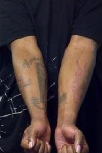 Tattoos on the bottom of both forearms