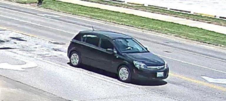 Front of suspect's vehicle - black Saturn Astra four-door hatchback