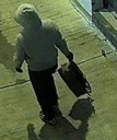 Person of interest carrying backpack used to transport each device