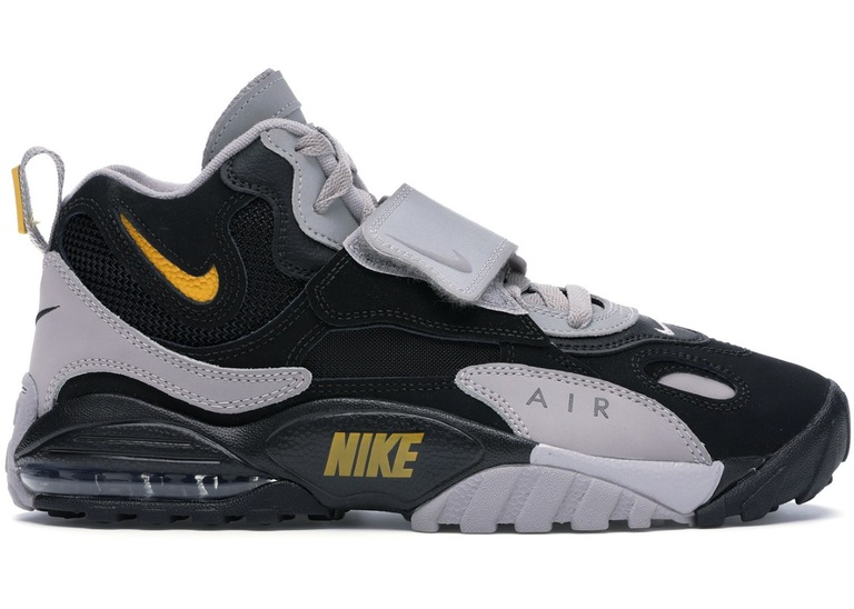 Example color photo of black and light grey Nike Air Max Speed Turf shoes with a yellow logo