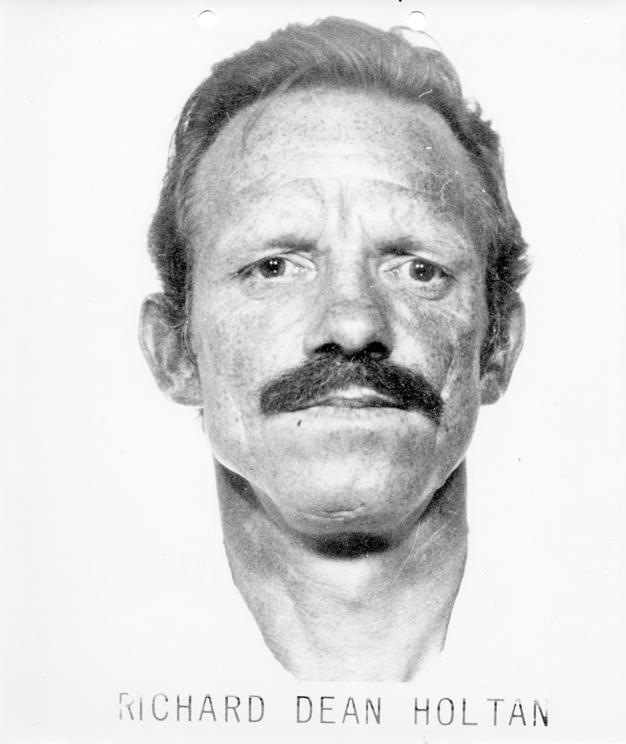 Former Ten Most Wanted Fugitive #331: Holtan surrendered to local authorities in Kauai, Hawaii on July 12, 1975.